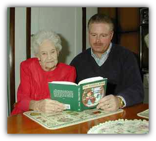 Image: Author, John Snyder, and his grandmother read The Golden Ring at the kitchen table.