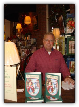 Image: Author John Snyder at a book signing.
